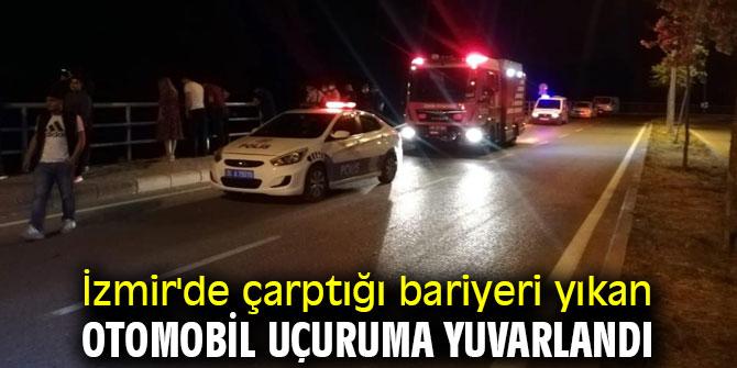 İzmir'de çarptığı bariyeri yıkan otomobil uçuruma yuvarlandı