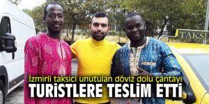 İzmirli taksici unutulan döviz dolu çantayı turistlere teslim etti