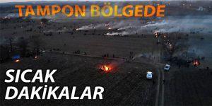 Mültecilere biber gazı ve ses bombası yağdırıyorlar.