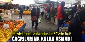 İzmirli bazı vatandaşlar evde kalmadılar, pazarda kalabalık oluşturdular