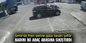 İzmir'de fren yerine gaza basan şoför, kadını iki araç arasına sıkıştırdı