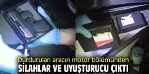 Aracın motor bölümünden silahlar ve uyuşturucu çıktı